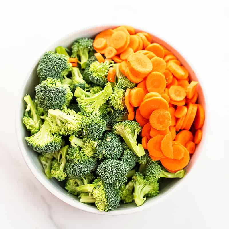 Bowl full of chopped broccoli and carrots.