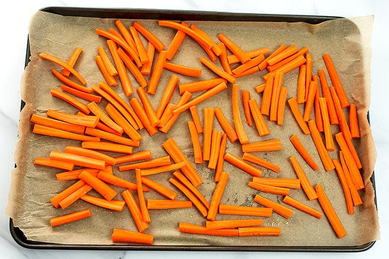 Carrot fries on baking sheet before cooking