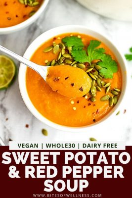 Spoon in a bowl of sweet potato red pepper soup.