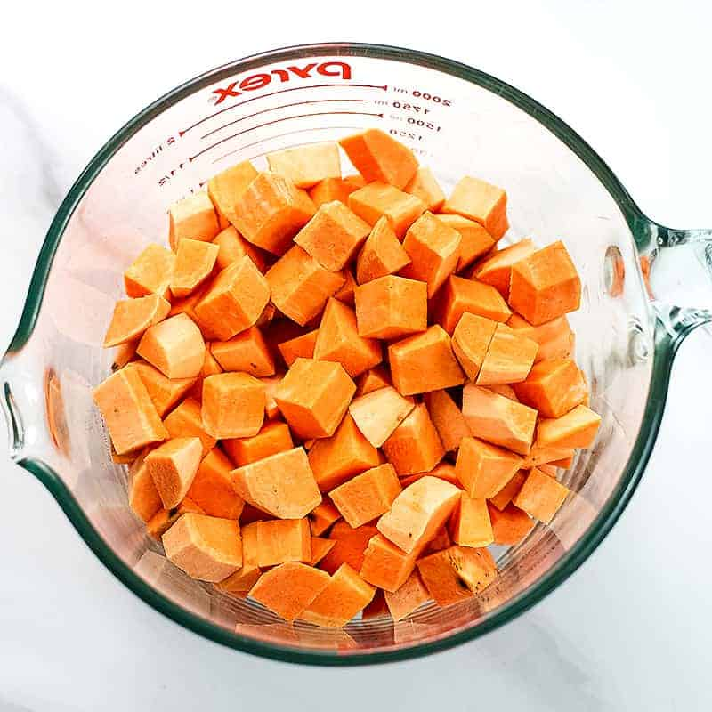 Cubed sweet potatoes in a mixing bowl.