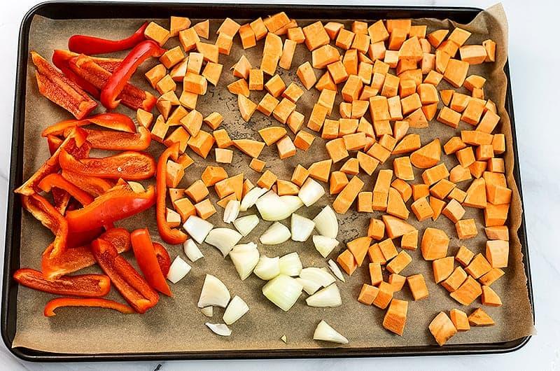 Vegetables for sweet potato red pepper soup before roasting.
