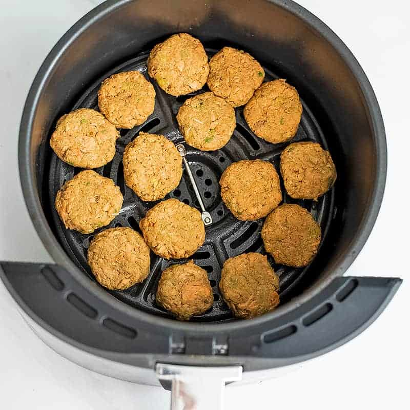Salmon bites in air fryer before cooking.