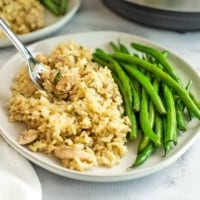 Plate filled with Chicken Thighs and Rice with green beans.