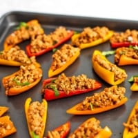 Gray baking sheet filled with mini pepper nachos.