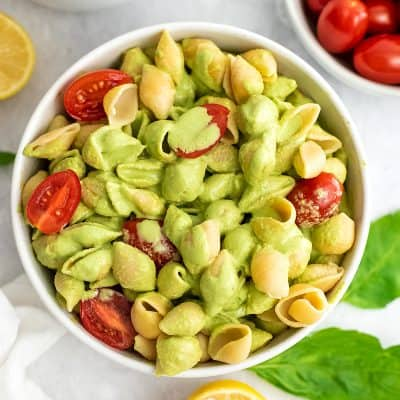 Creamy tahini pesto on top of pasta and veggies.