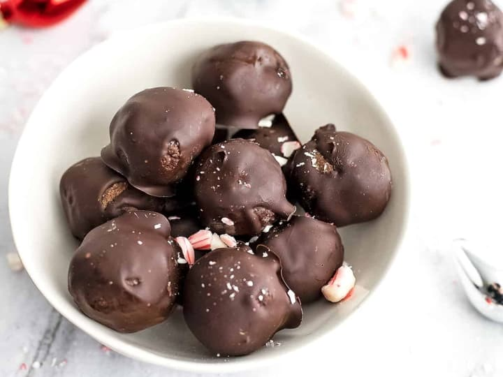 Chocolate mint energy balls in a white bowl.
