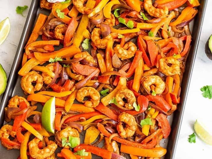 Sheet Pan of shrimp fajita ingredients after cooking.
