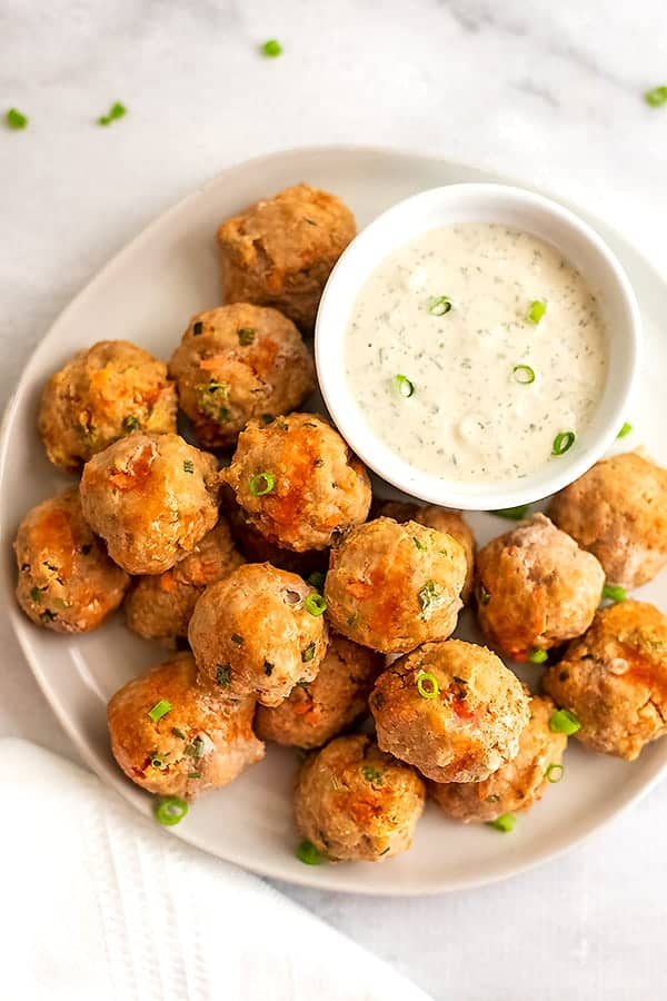 Plate filled with buffalo turkey meatballs with a side of ranch.