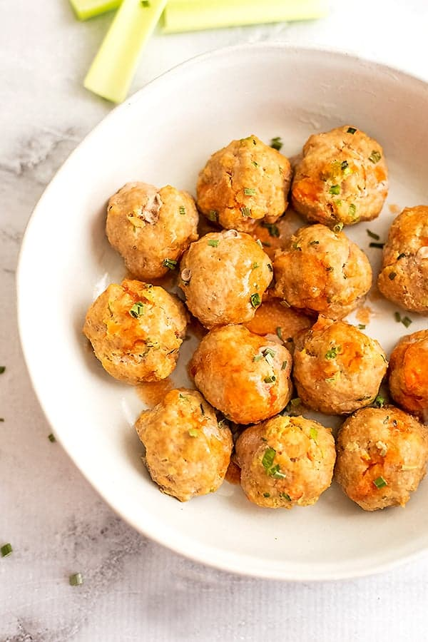 White bowl filled with buffalo turkey meatballs.