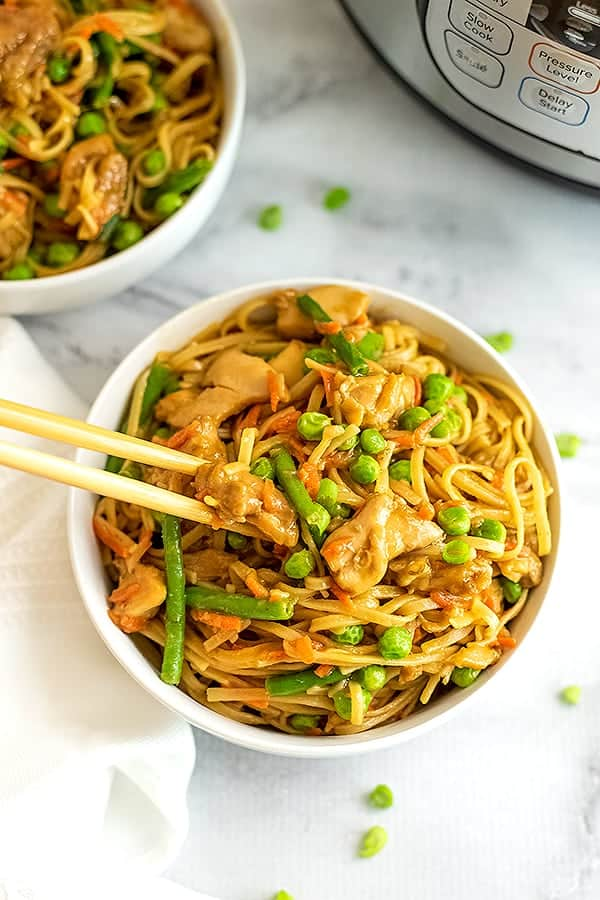 Chopsticks getting a serving of Asian Chicken and pasta