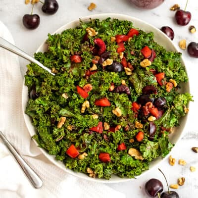 Bowl of cherry kale salad with a fork in the bowl.