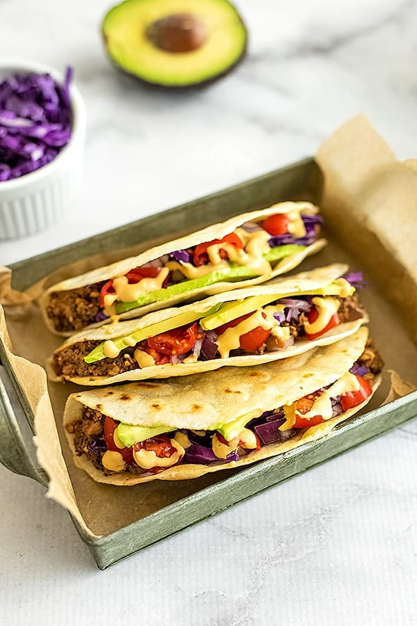 Three tacos with mushroom walnut taco meat.