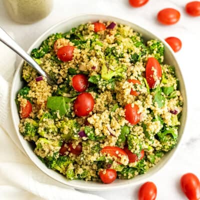 Italian quinoa salad in a large white bowl with fork in salad.