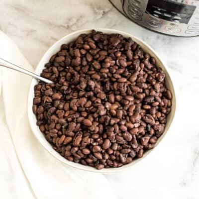 Bowl filled with black beans made in Instant Pot.