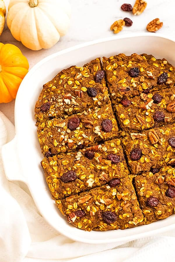 Pumpkin breakfast bars in white baking pan.