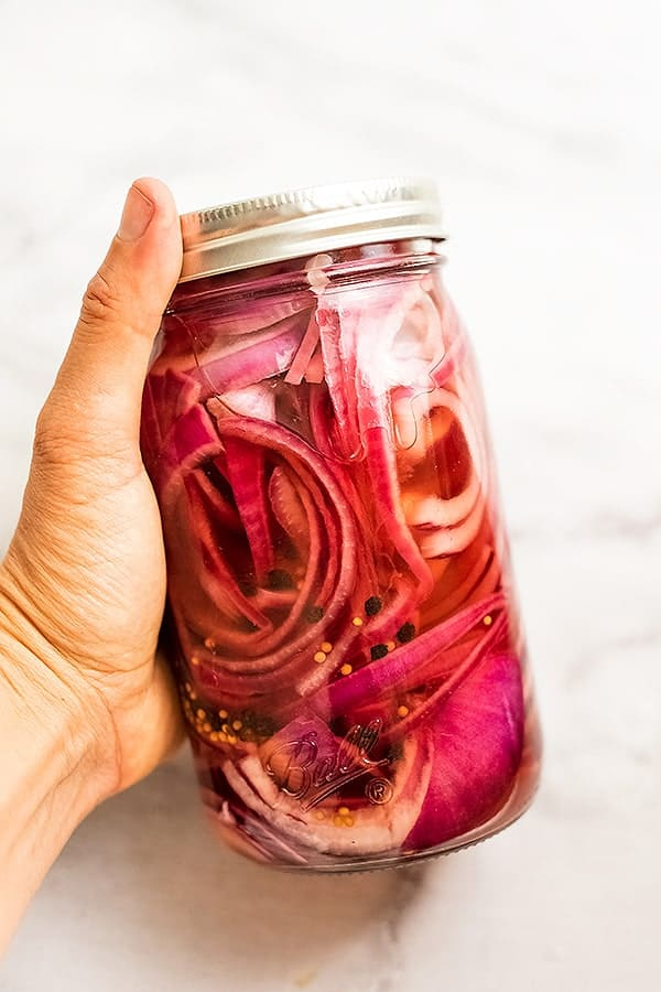 Glass jar of Whole30 pickled red onions.