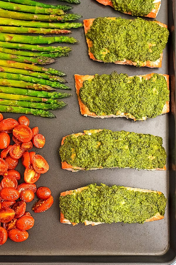Sheet pan with pesto crusted salmon and vegetables.