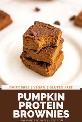 Pumpkin brownie with a bite removed on a plate.