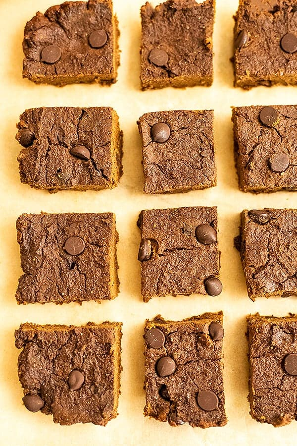 Pumpkin protein brownies on parchment paper.