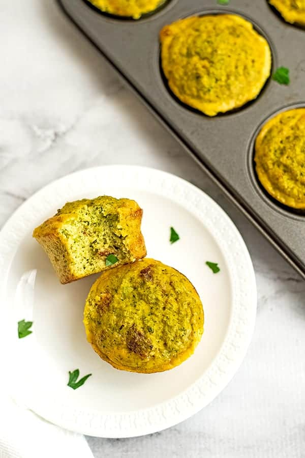Egg muffins on a white plate with a bite taken out of one.