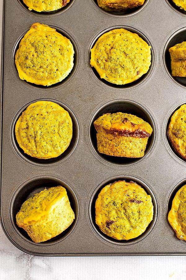 Whole30 cheesy broccoli egg muffins in a muffin tin.