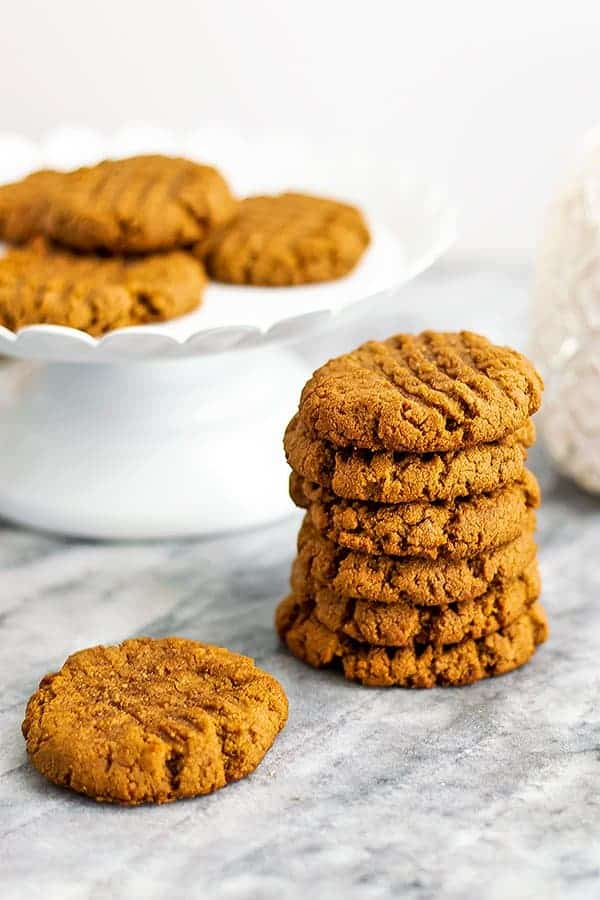 Protein peanut butter cookies stacked on top of each other.