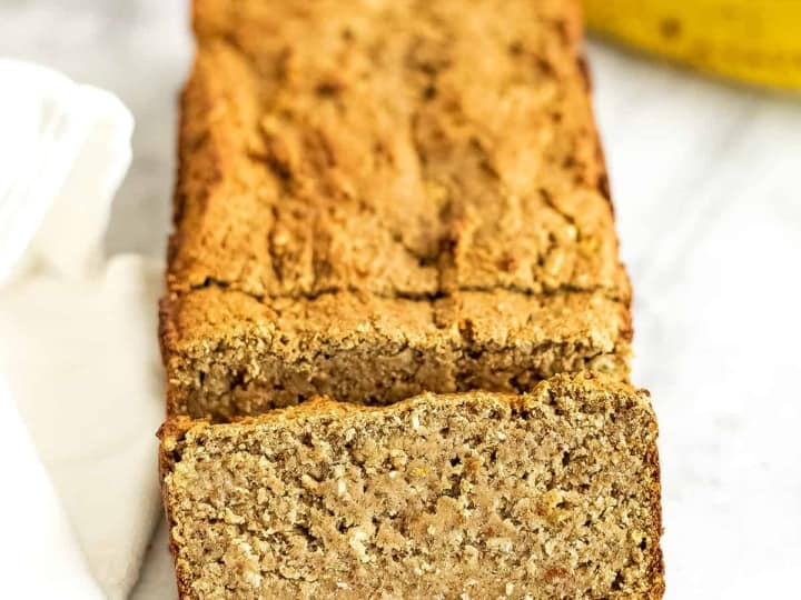 One slice of protein banana bread in front of the loaf.