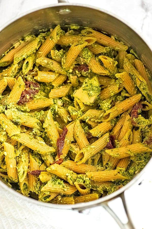 Silver pot filled with pesto tuna pasta after stirring.