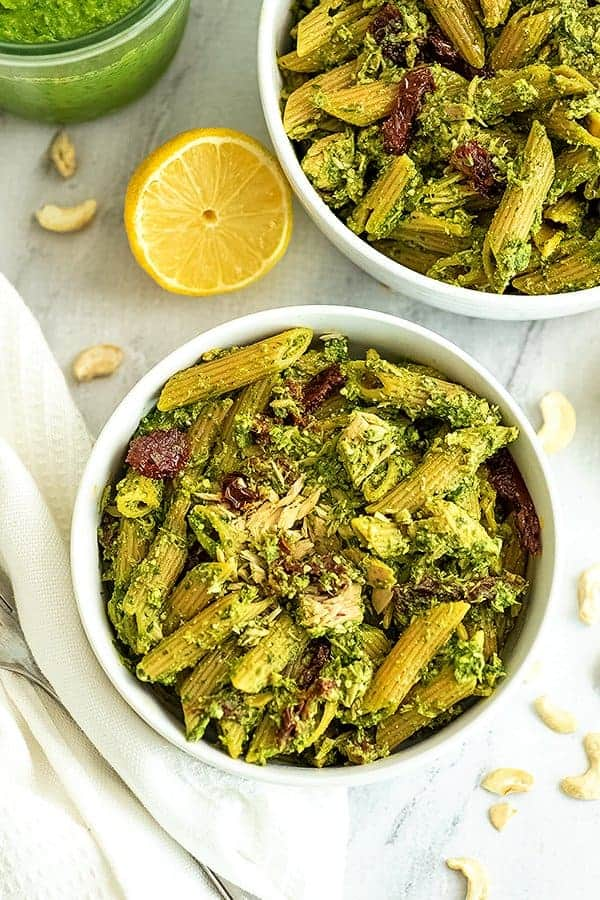 Bowl of pesto tuna pasta with a fork to the side.