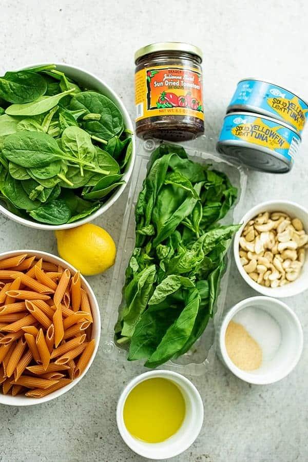 Ingredients to make tuna pesto pasta.