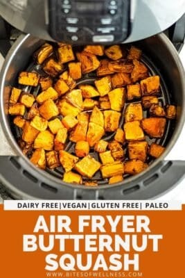 Air fryer basket filled with butternut squash cubes.