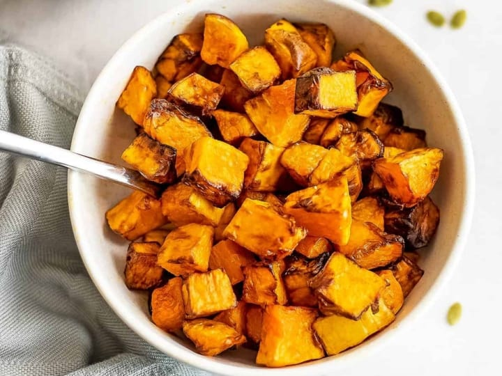 Bowl filled with air fryer butternut squash.