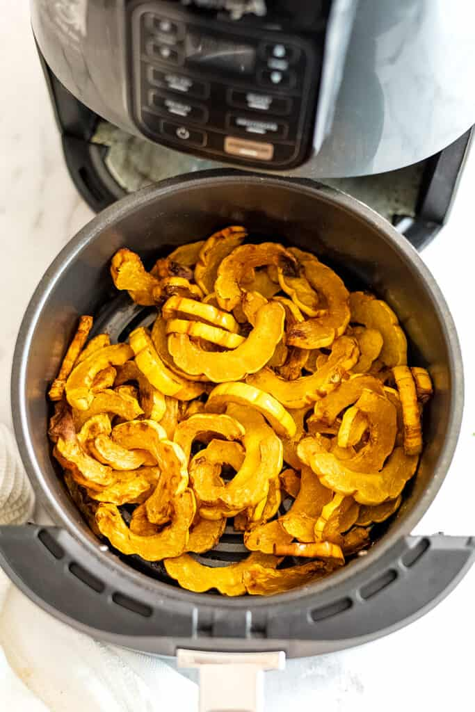 Roasted delicata squash in the air fryer basket.