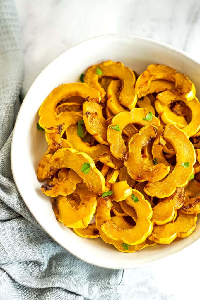 White bowl filled with delicata squash fries.