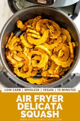 Air fryer basket full of delicata squash fries.