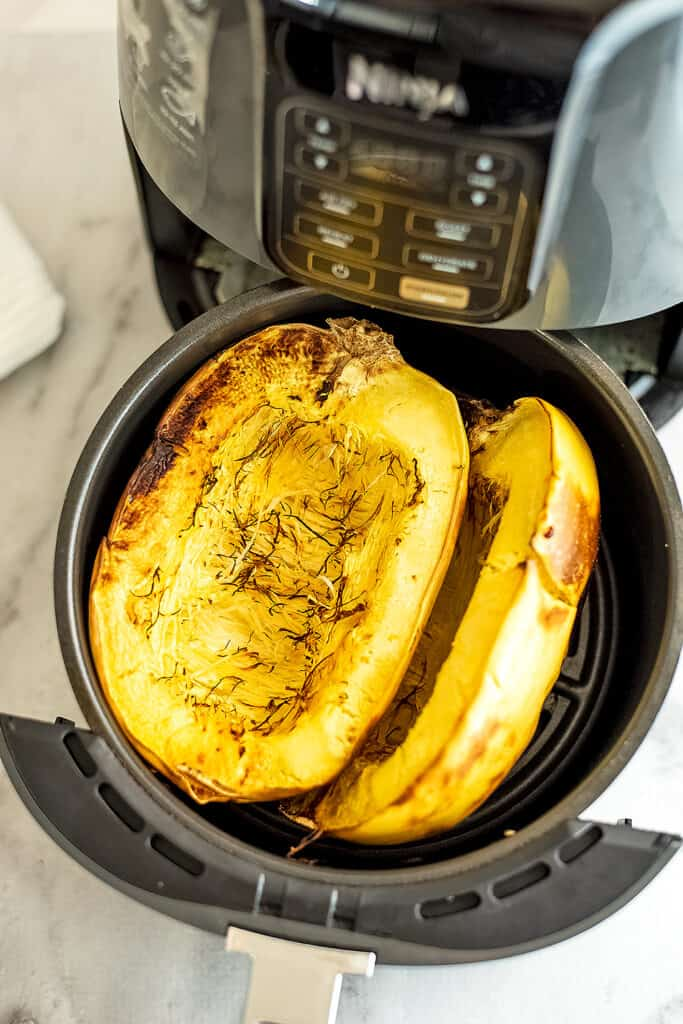 Spaghetti squash in air fryer after cooking.