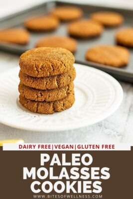Paleo molasses cookies on a plate stacked 4 high.