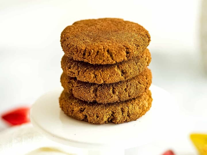 Paleo molasses cookies stacked on top of each other.
