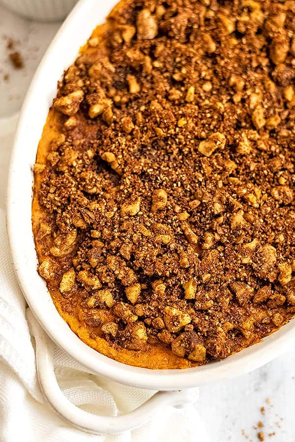 Sweet potato casserole topped with chopped pecans.