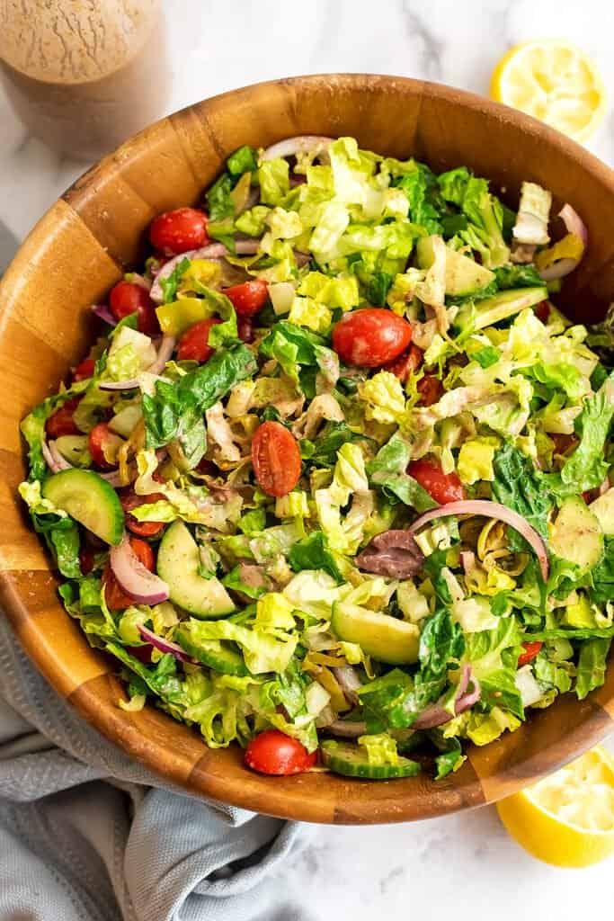 Greek salad in a wooden bowl.