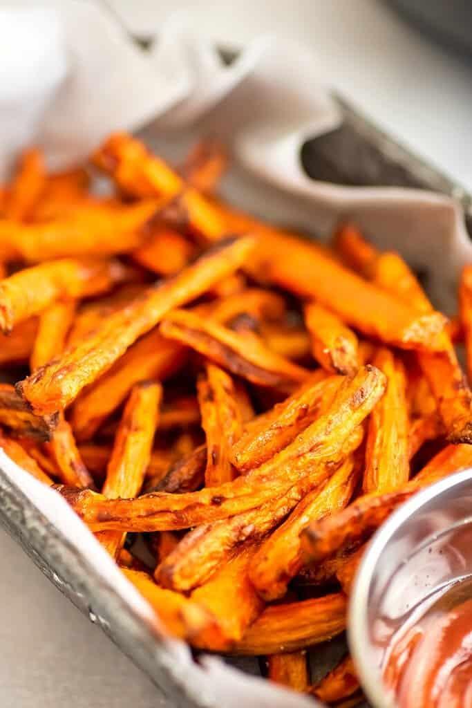 Air fryer carrot fries in a basket.