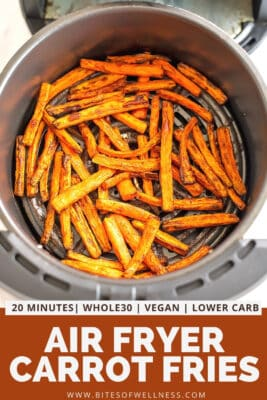 Air fryer basket full of cooked carrot fries.