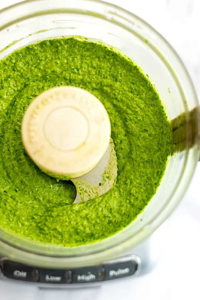 Food processor filled with white bean pesto.