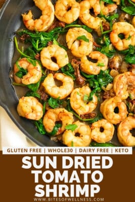 Cast iron skillet filled with sun dried tomato shrimp.