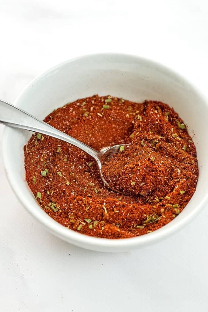 Spoon in a bowl of low fodmap taco seasoning