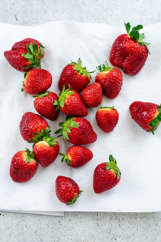 Strawberries on a paper towel to dry.