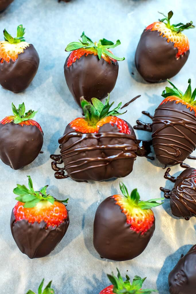 Chocolate drizzled on a chocolate covered strawberry.