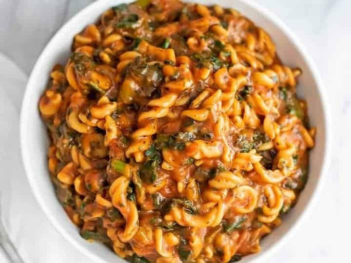 Large bowl filled with pasta sauce and marinara.