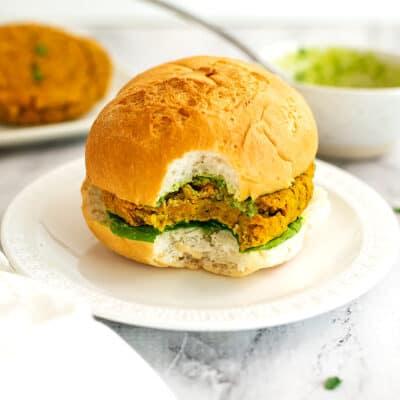 Sweet potato lentil burger on a bun with a bite taken.