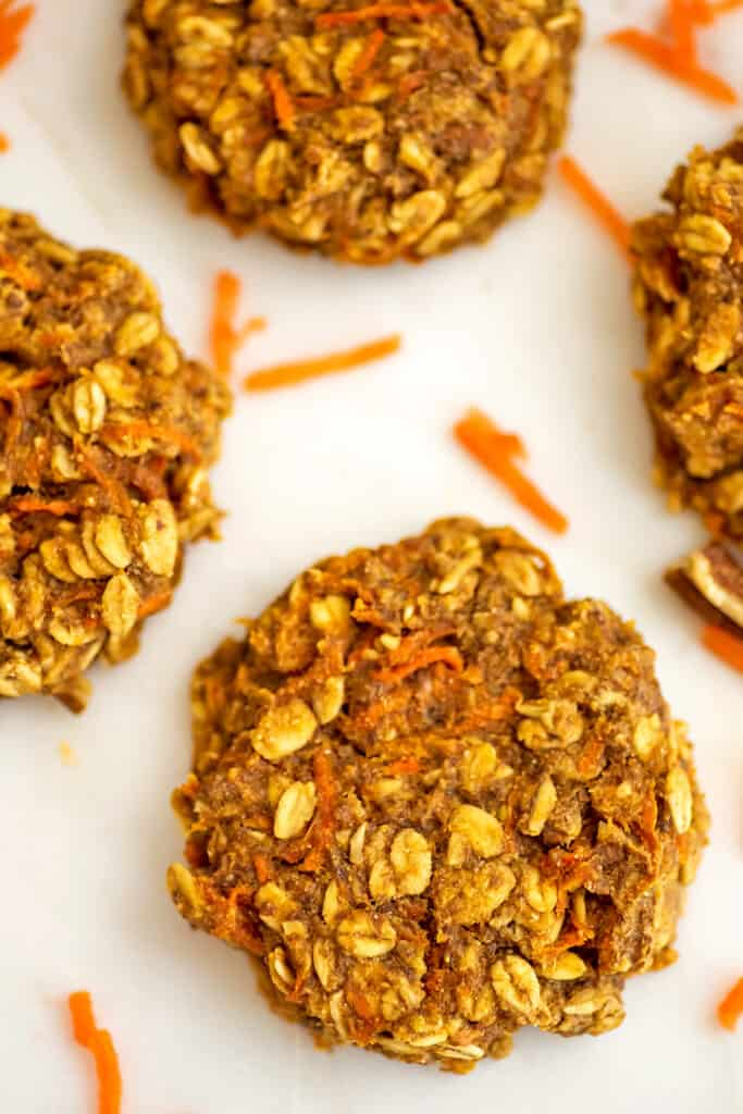 Carrot cake cookies without frosting on a white tray.